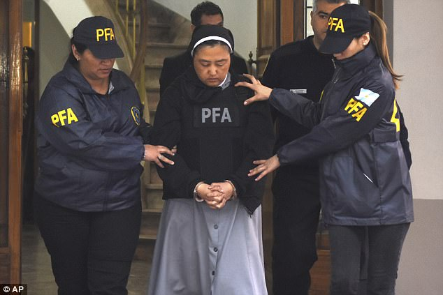 The Japanese-born nun, who has Argentine citizenship, allegedly helped the priests with anal and vaginal rapes, fondling and oral sex  - which were allegedly committed in the bathrooms, dormitories, garden and a basement at the school in Lujan de Cuyo