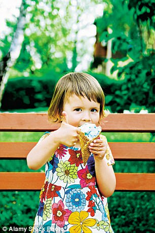 A youngster enjoys a giant ice cream sundae. Portstewart has an ice cream parlour that has been open since 1911
