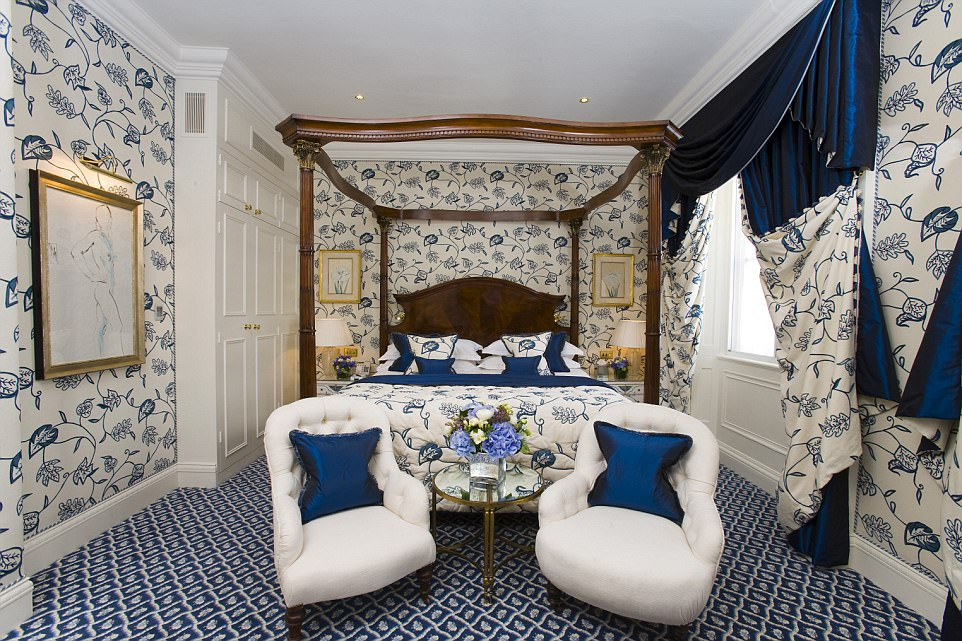 Plush: Fiona stayed in the 'divine' Philippe Suite, a set of rooms in navy and cream with three crystal chandeliers and a four- poster bed