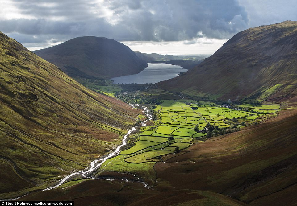 Shifting light: In his book Photographing The Lake District: A Guide to the Most Beautiful Places, Holmes reveals some of his favourite spots to snap (above, views over theWasdale valley from the slopes of Great Gable)