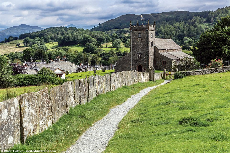 Seeking solace: Hawkshead church is situated in stunning scenery in the southern Lake District, between Windermere and Coniston.A chapel existed on the site in the 12th century