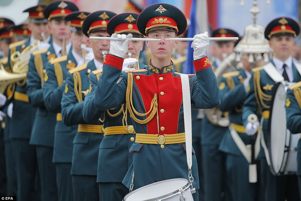 The event included a performance from a military band. Parades were held across Russia's sprawling expanse