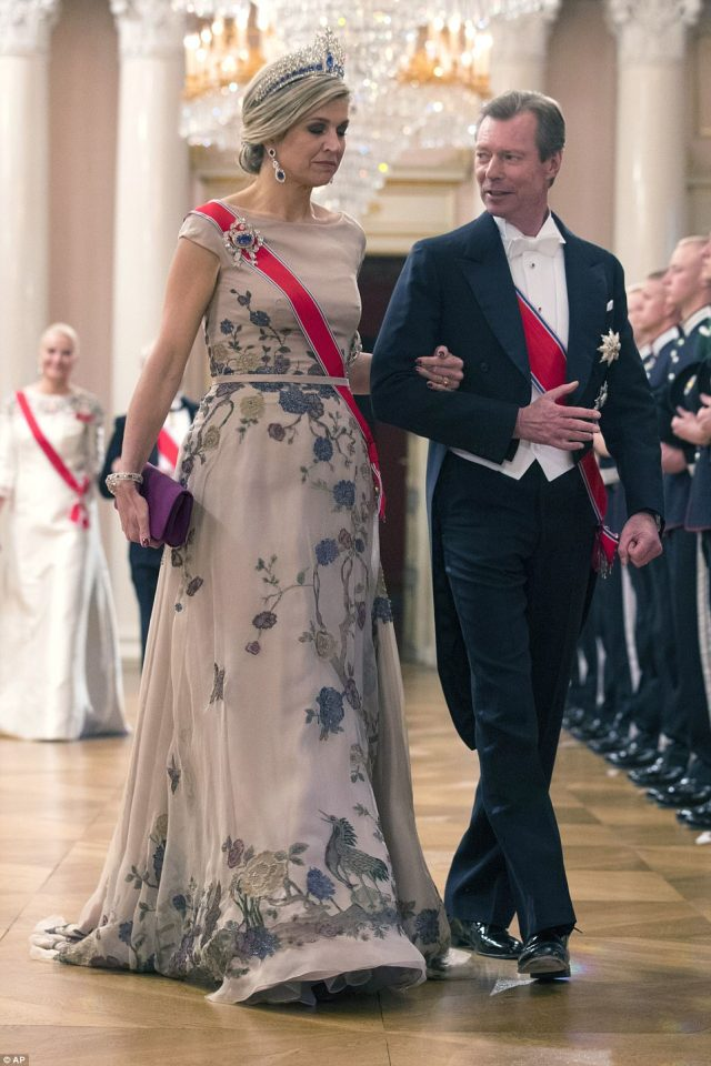 Grand Duke Henri of Luxembourg and Queen Maxima arrive, with the blonde royal wearing matching diamonds and tiara