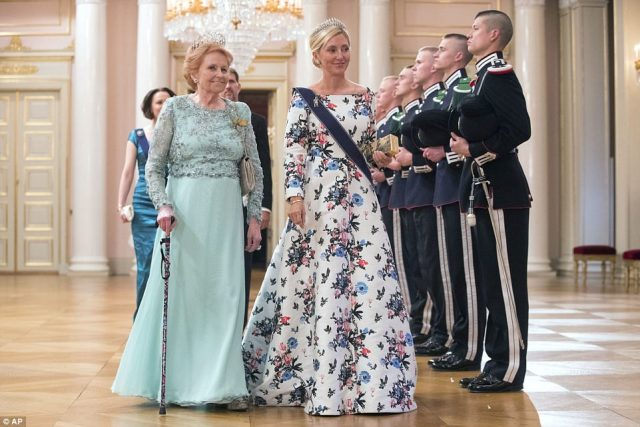 Crown Princess Marie Chantal of Greece, right, and Lady Elizabeth Shakerly of Great Britain make a stylish arrival