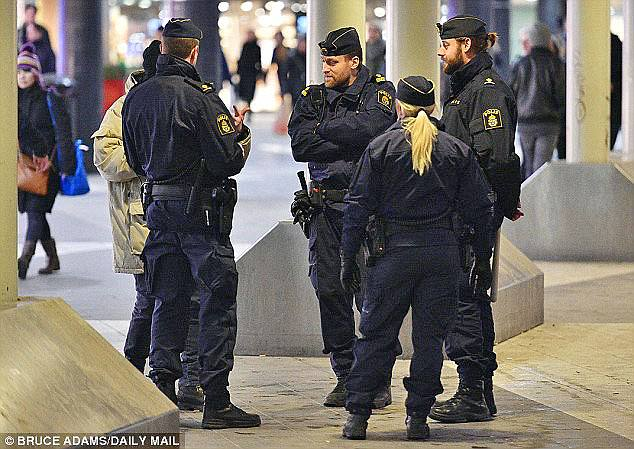 Sweden has a much more negative view of immigration following a spate of horrifying sex attacks, a new reports finds (pictured immigration officers)
