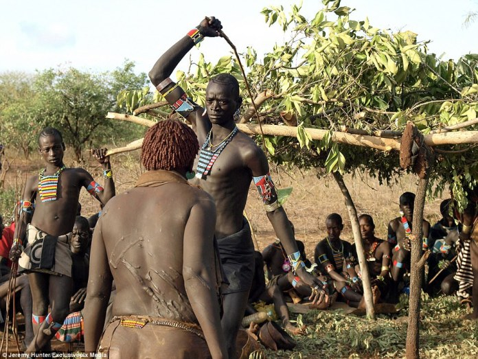 Hamar women of the Lower Omo Valley, Southern Ethiopia willingly submit themselves to be whipped during the ceremony of Ukuli Bula