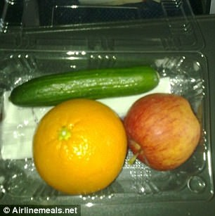 Random: One passenger was served an apple and orange with a courgette