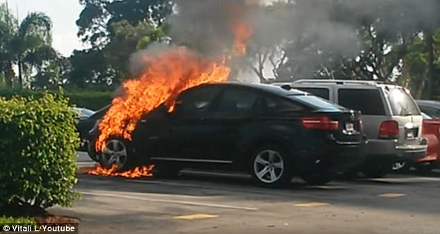 A parked 2012 BMW X6 is seen engulfed in flames in Delray Beach, Florida in July 2015