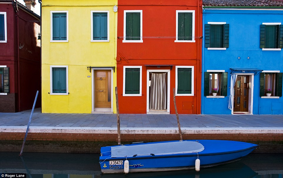 Bright idea: The colourful canal-side houses on the island of Burano in the Venetian Lagoon