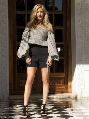 Effortless beauty: Ellie looked effortless chic as she accentuated her ample assets in the fitted garment, complete with elegant puff sleeves.
