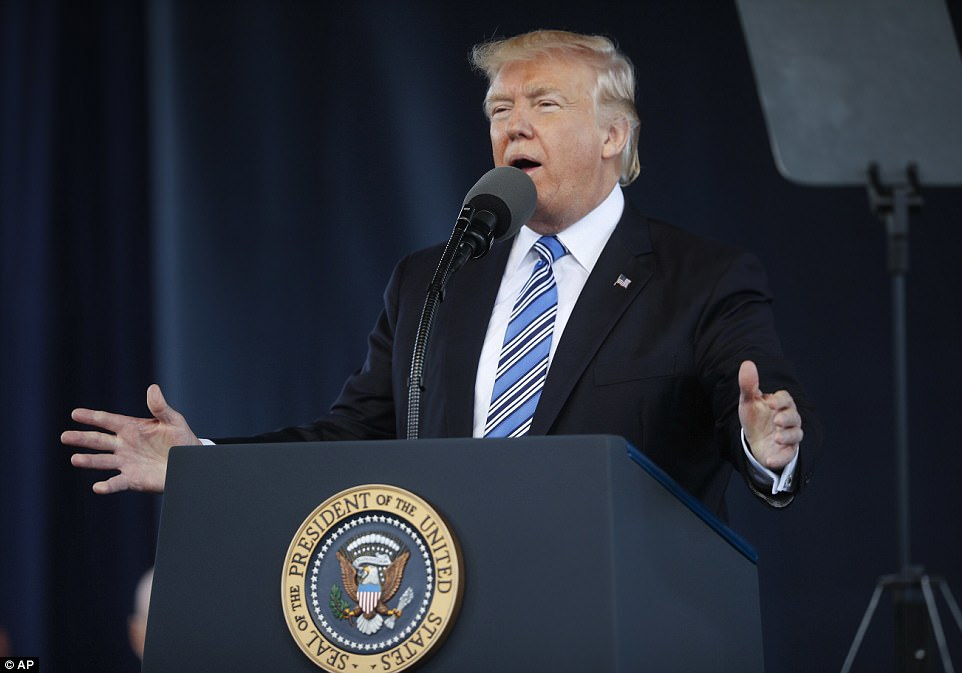 President Donald Trump was met with a standing ovation by school administrators, faculty, staff and students, as he was welcomed by to the stage. 'There's no place in the world I'd rather be to give my first commencement speech as president than Liberty University,' Trump said as he began his speech to the 18,000 graduates