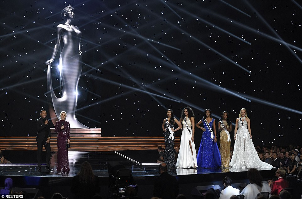 Julianne Hough (second from the left) and Terrence J (far left) hosted the show, and this year's competition included five women who immigrated to the U.S. at a young age and now as citizens hoped to represent the nation on a global stage, including miss New Jersey (5th from the right)