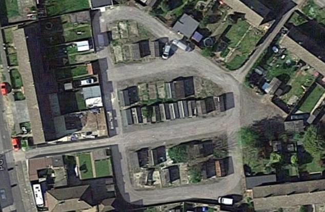 Police said the garages (seen from above) became the centre of the search after a tip-off