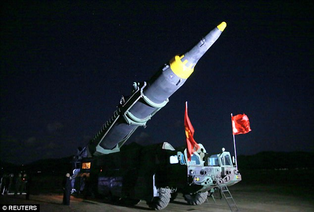 Kim Jong-un (pictured left as the missile is moved into position) has claimed the new projectile can range the mainland United States