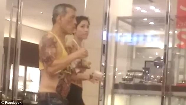 The king has heavy tattoos on his arms, back and stomach in the footage, which shows him wearing a yellow crop top. However, the tattoos may actually be transfers as they are not the same as those seen in photographs taken at Munich airport earlier in 2016