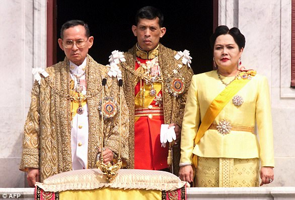 Strict laws in Thailand impose heavy sentences on those judged to have insulted the monarchy. King Maha Vajiralongkorn is pictured with his father, King Bhumbol Adulyadej, who died last year, and Queen Sirikit