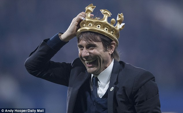 Conte smiles as he wears an inflatable crown after the 4-3 victory over Watford on Monday