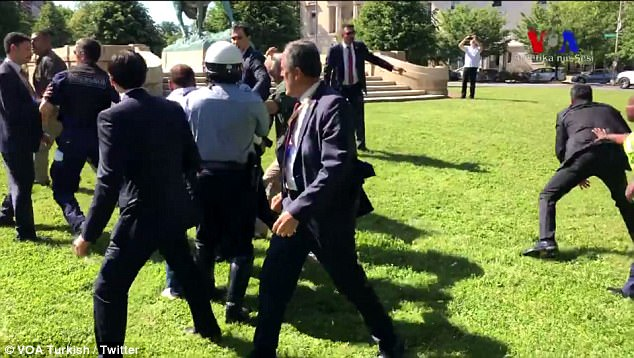 The men wearing suits appeared to start the physical altercations - based on videos posted online on Tuesday
