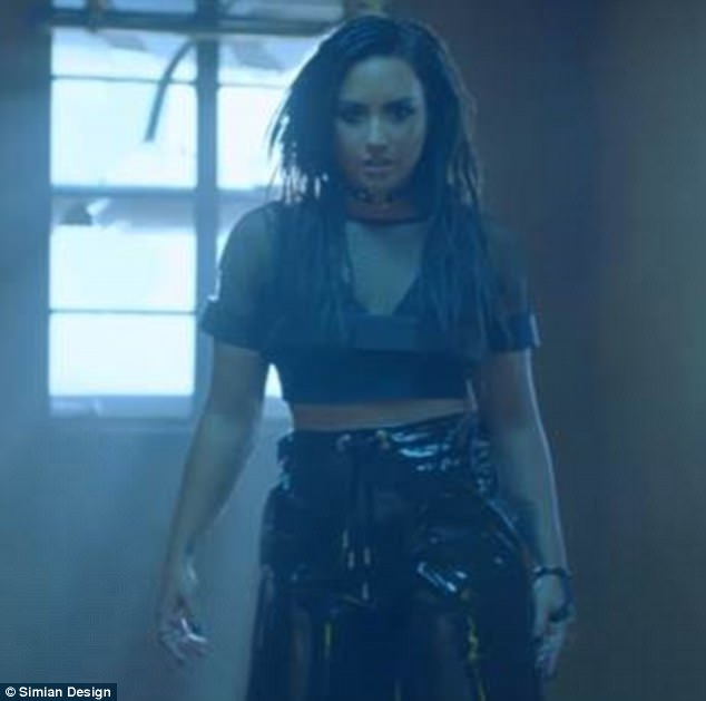 Faux pas: Demi Lovato has faced accusations of cultural appropriation for wearing dreadlock-style hair in her new music video, which she unveiled online Tuesday