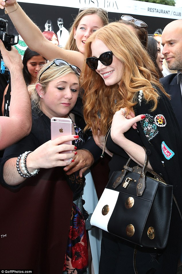 Shady: Jessica hid her eyes behind a pair of designer sunglasses as she posed for selfies with fans