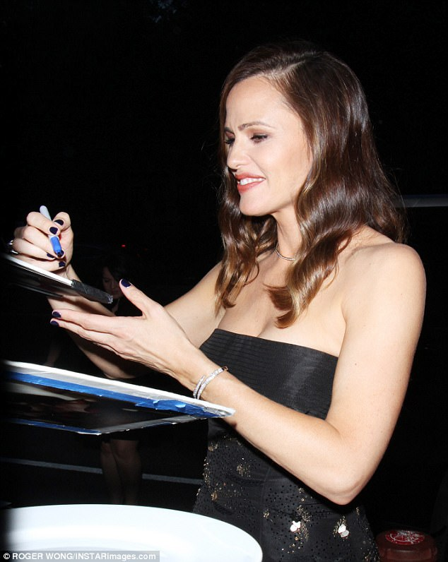 In demand: The beauty signed autographs in the Big Apple as she arrived at the screening