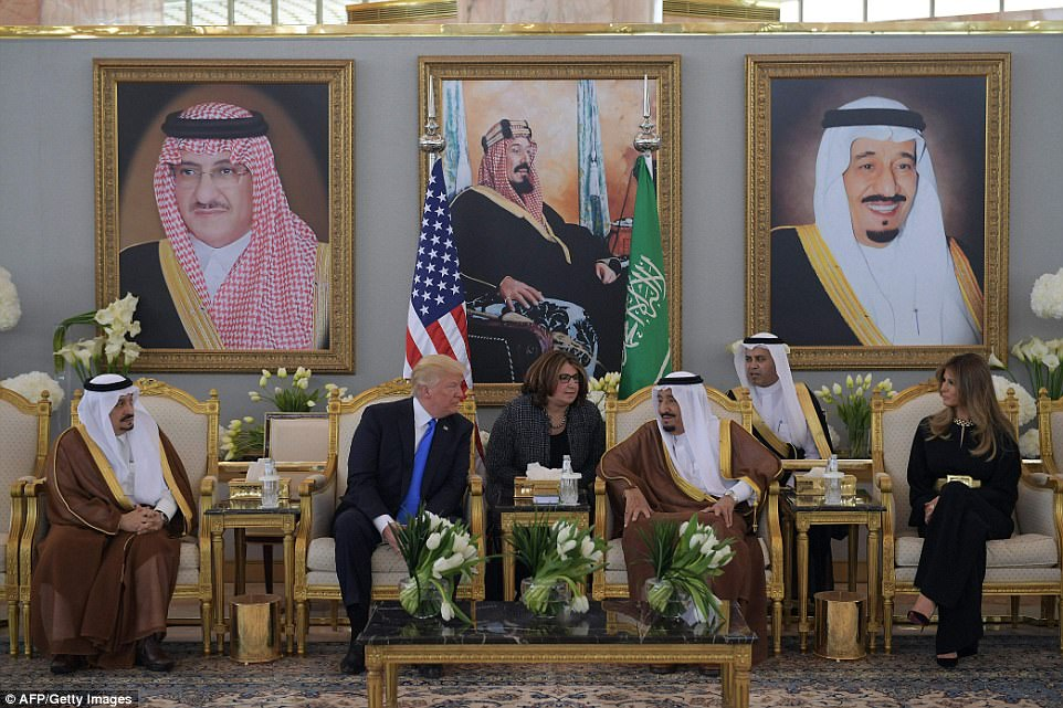 Despite his domestic troubles, Trump was expected to get a warm reception in Saudi Arabia, where he is pictured centre left with the country's King Salman, pictured centre right