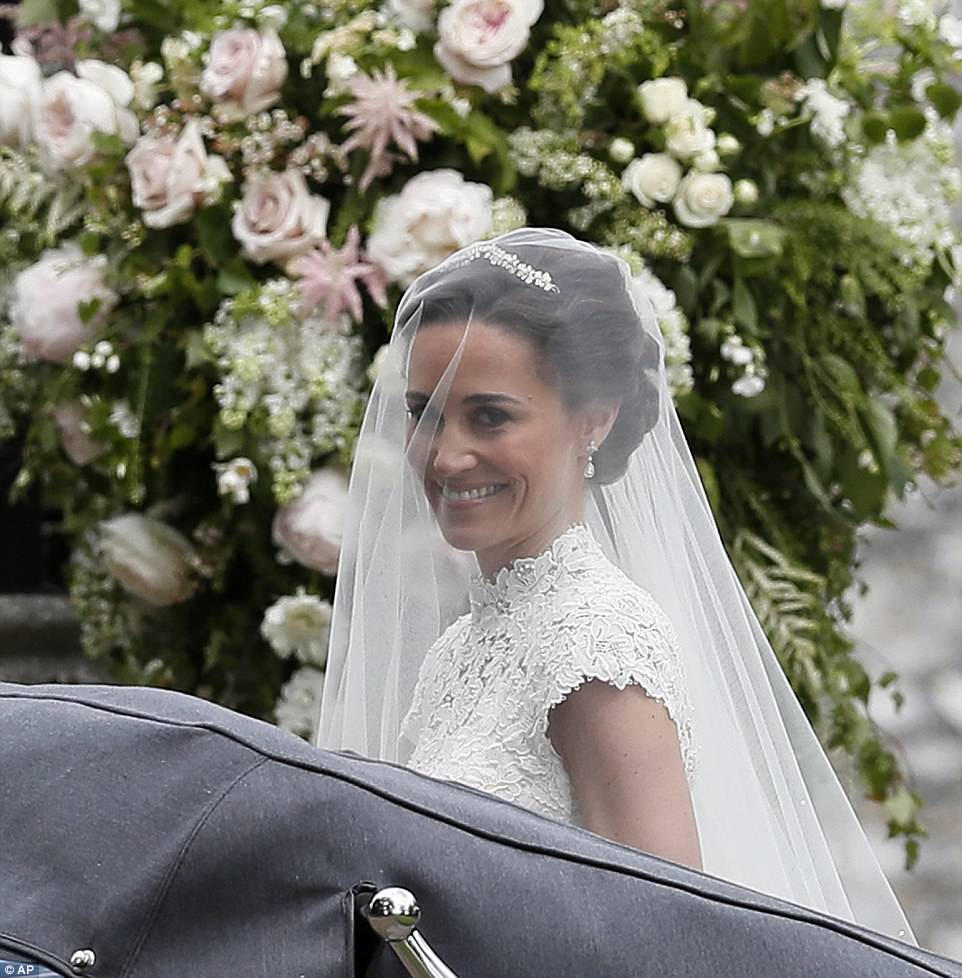 Pippa couldn't stop smiling as she arrived at the church to marry her financier boyfriend James Matthews