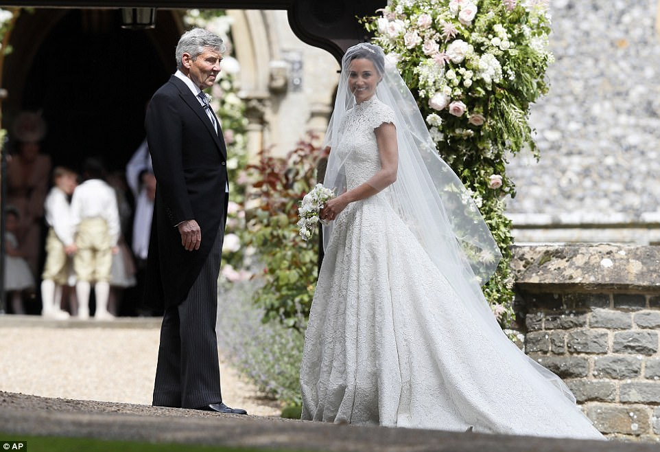 Pippa Middleton arrives with her father Michael Middleton for her wedding to James Matthews at St Mark's Church