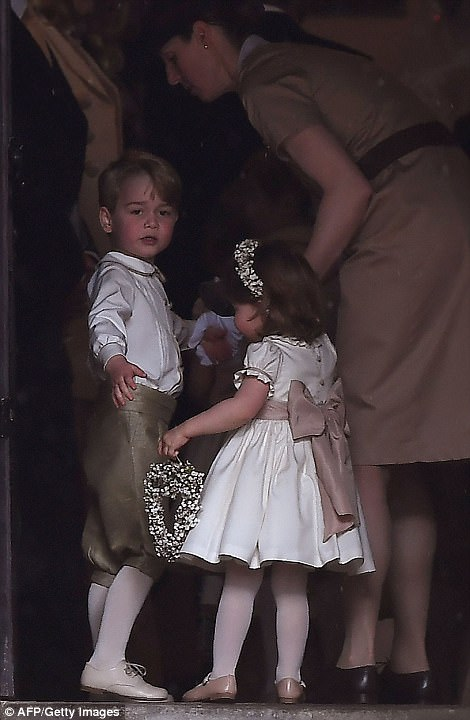 Prince George played the caring big brother as he reached for his little sister's hands as they made their way inside