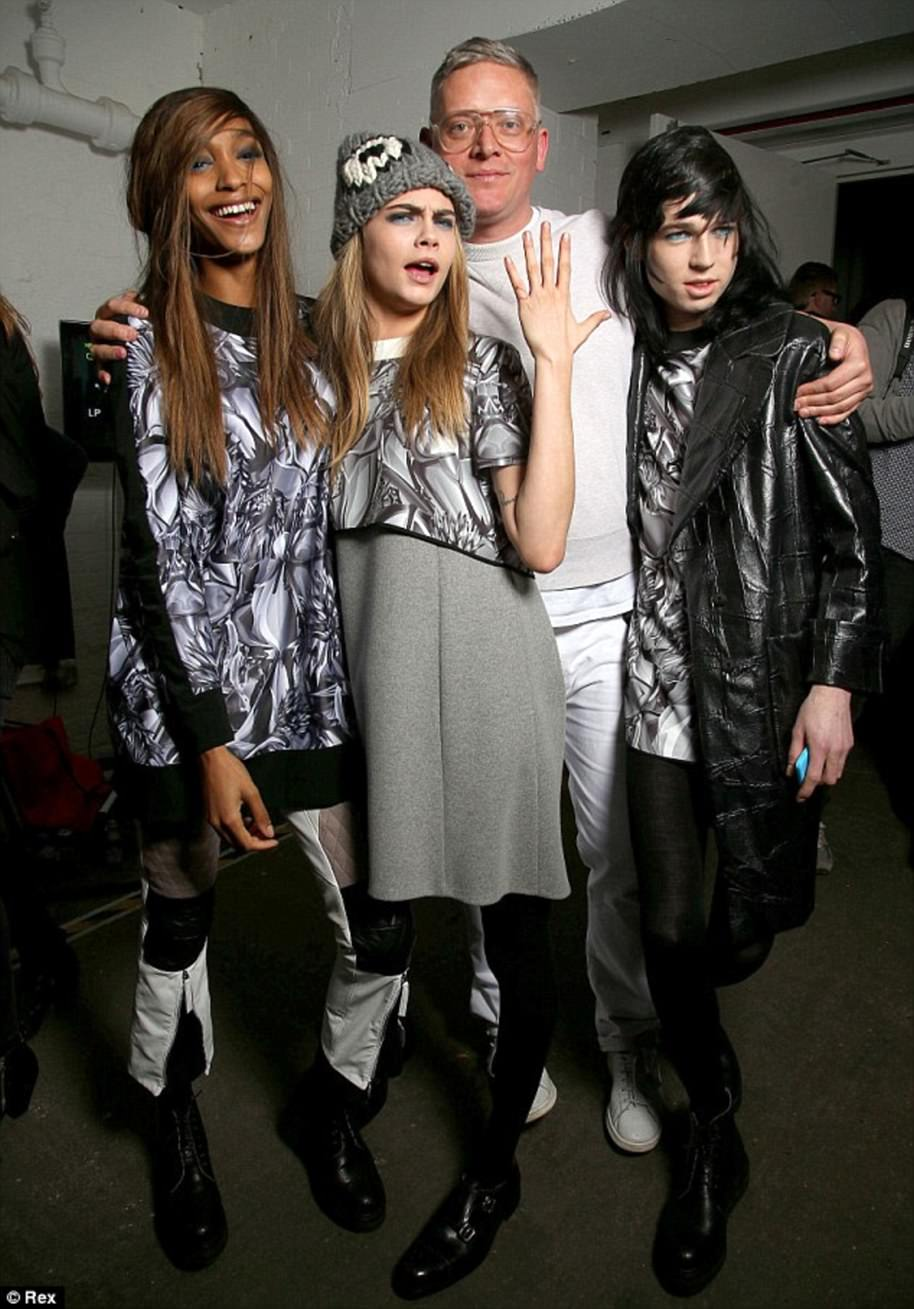 Giles, pictured with models Jourdan Dunn and Cara Delevingne at his fashion week event, has forged a close circle of famous friends. He is reported to have first met with Pippa and mother Carole last summer to discuss dress options