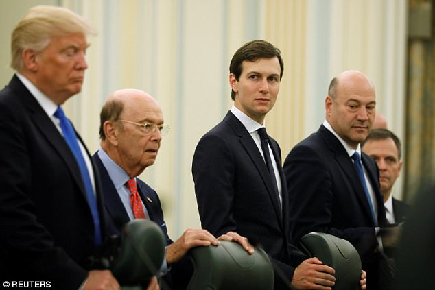 White House chief economic adviser Gary Cohn (right) told reporters that a series of defense contracts inked Saturday would mean 'a lot of money, big dollars' for American companies
