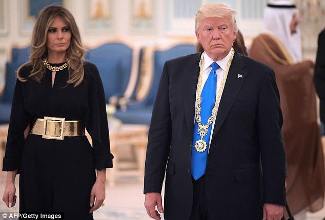 Donald Trump and First Lady Melania Trump make their way to a luncheon after Trump received the gold King Abdulaziz medal