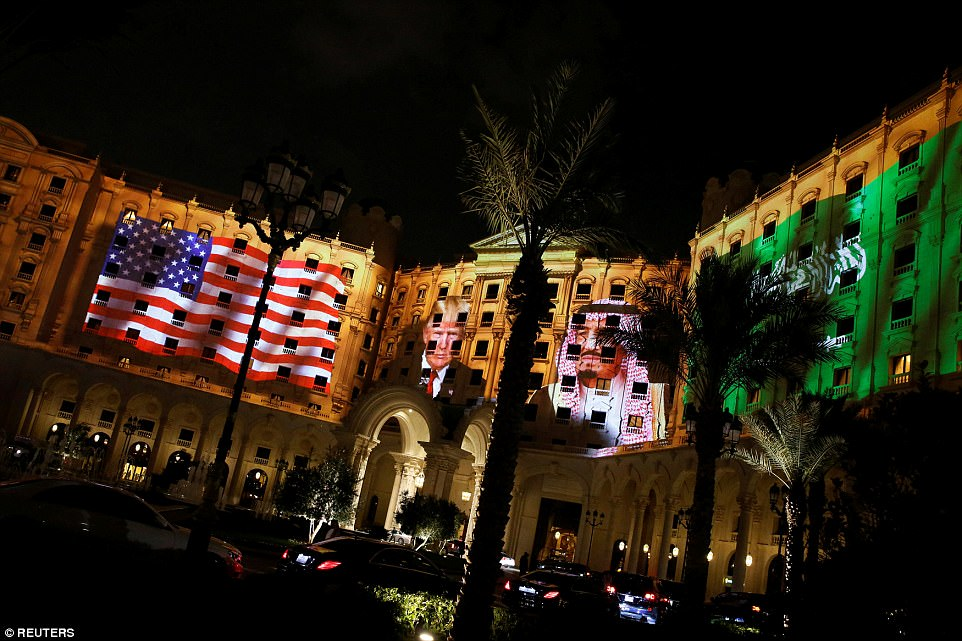 Pictures of Trump and Saudi Arabia's King Salman are projected on the front of the Ritz-Carlton, where Trump is staying in Riyadh