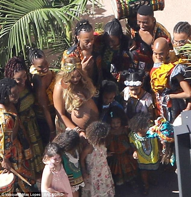 Her tribe: Beyonce was spotted with henna tattoos on her baby bump as she celebrated at her African theme baby shower