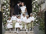 Pippa Middleton, background right, kisses James Matthews after their wedding at St Mark's Church in Englefield