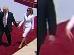 President Trump tries to hold hands