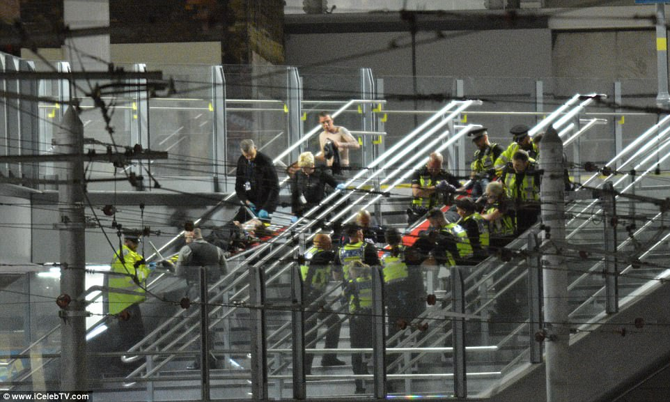 Casualties are stretchered out of the concert tonight after a terror attack in the Ariana Grande concert