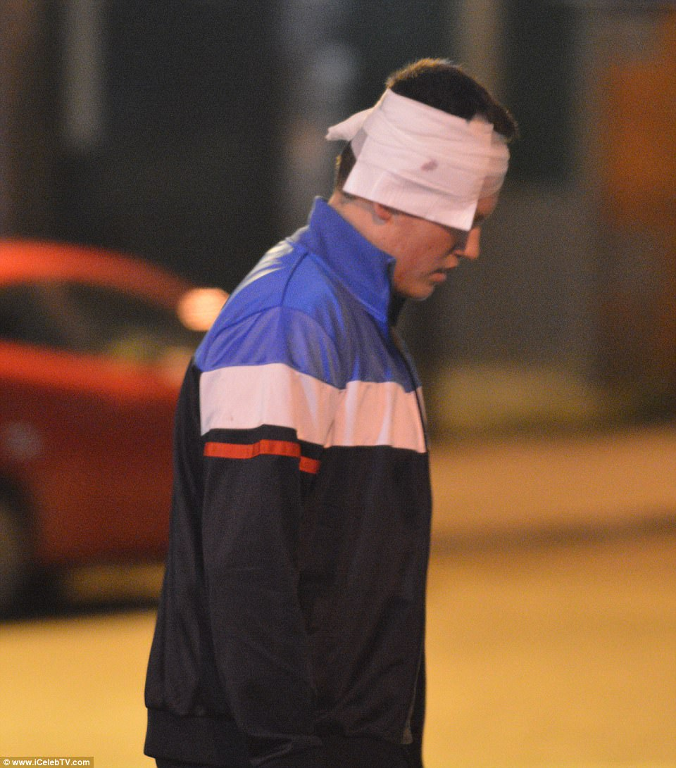 A man with a bandage on his head exits the arena after the terror attack inside the Manchester Arena