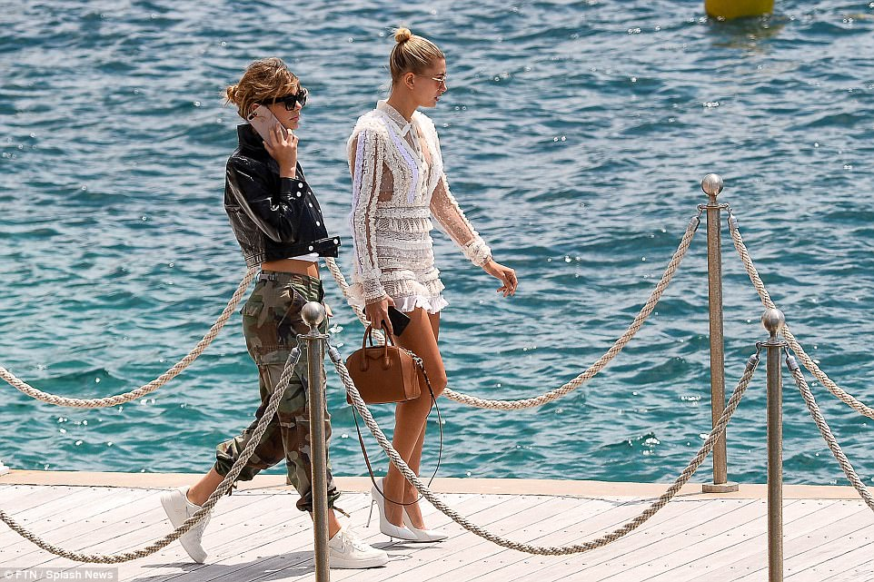 Making it their catwalk: Hailey and her model pal strutted down the boardwalk towards their boat