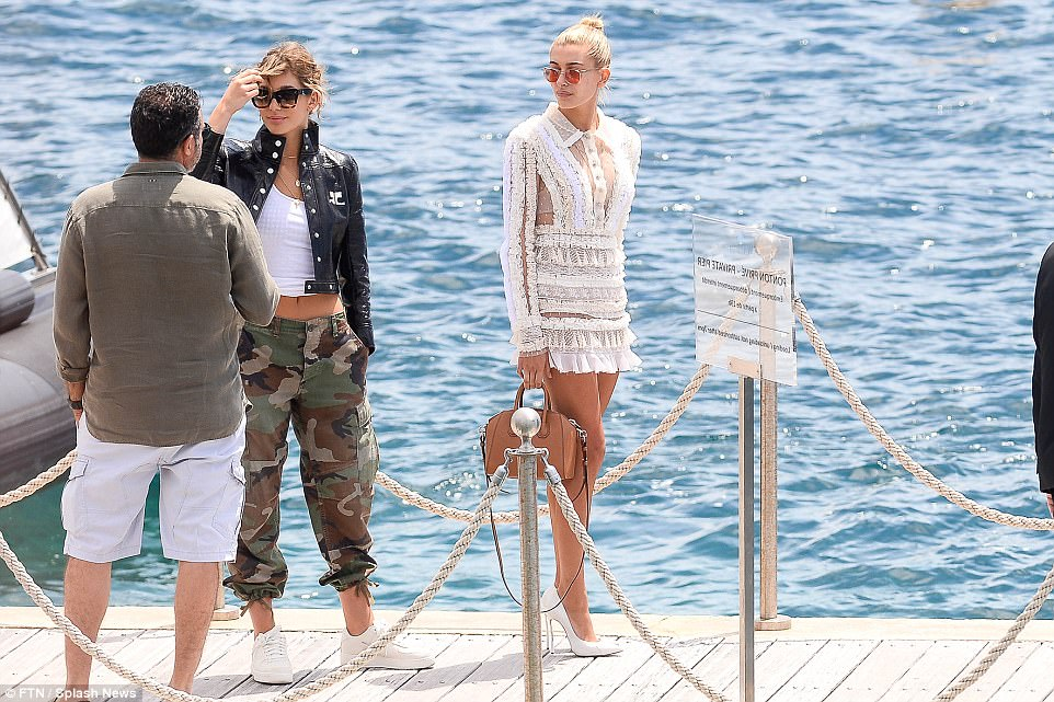 Looking al-white! Earlier in the day she had been spotted boarding a speedboat to take her to the yacht, dressed in a summer white ensemble