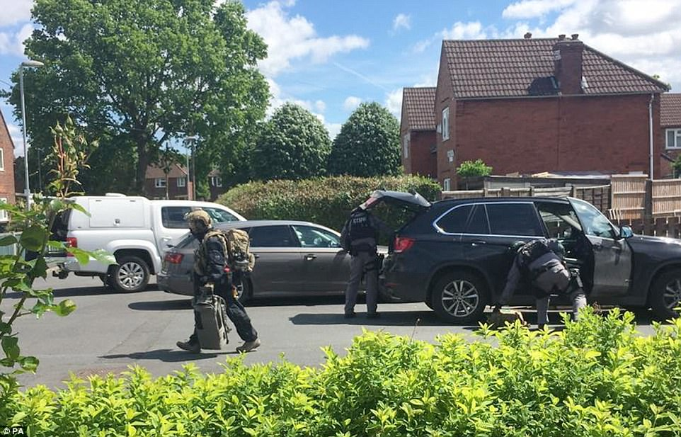 Explosives experts were brought in to an otherwise quiet residential street where it is believed the suicide bomber lived