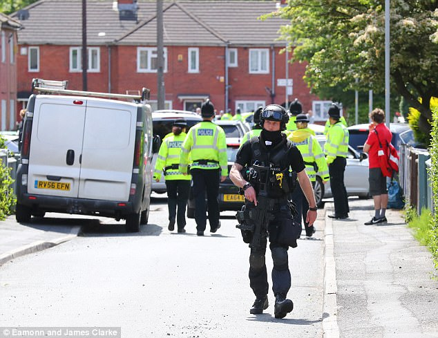 A large police presence, including armed officers, was seen outside an address about a mile from the scene of the arrest