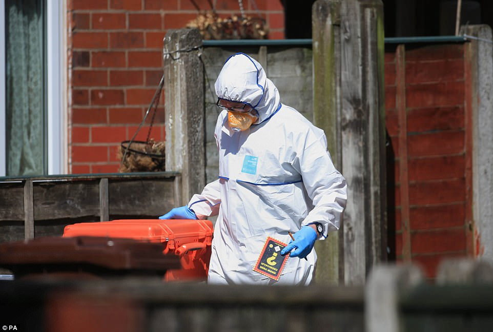 A forensics expert leaving Abedi's house this afternoon was seen holding a police issue book called 'Know Your Chemicals'