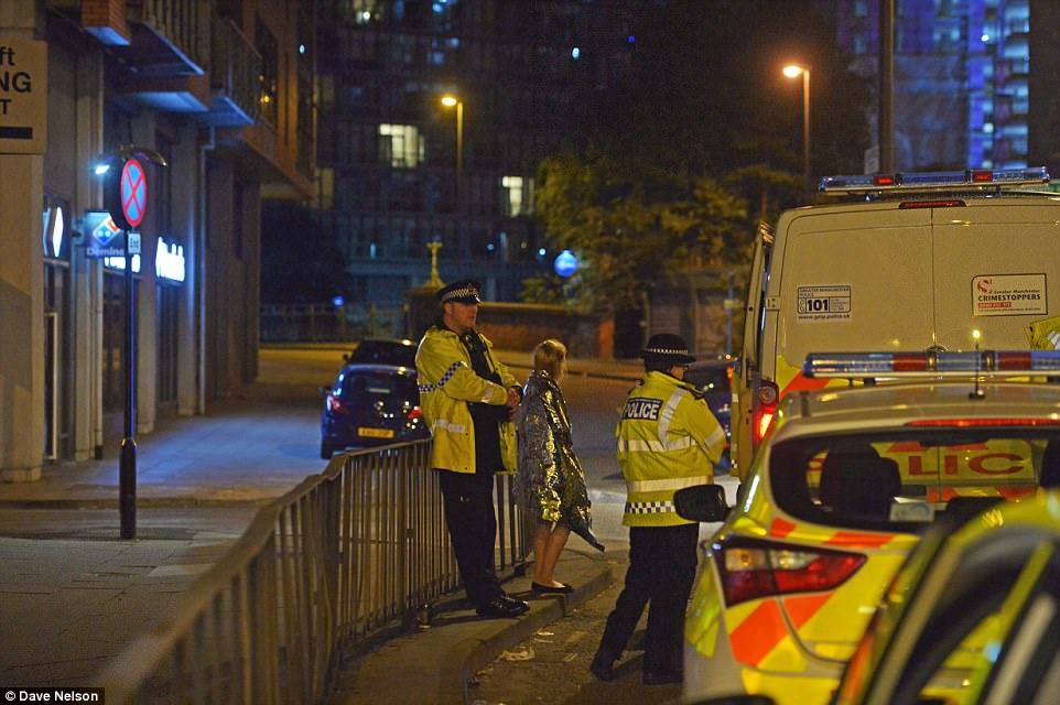 Prime Minister Theresa May said the government is trying to establish 'the full details' of the attack. Pictured: A young victim wearing a foil thermal top is helped by police
