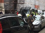 Armed officers, believed to include special forces soldiers, raid a property in central Manchester less than two miles from Manchester Arena. Soldiers, deployed all over the UK today, were involved in the raid and BBC diplomatic editor Mark Urban said one trooper was carrying UK Special Forces gear and a jamming backpack