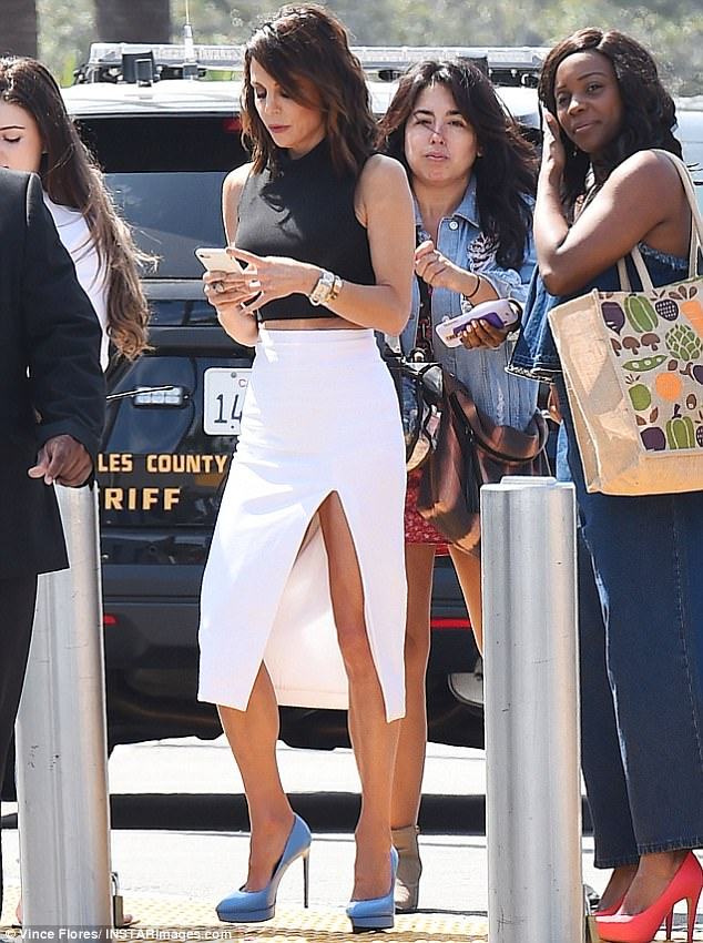 All business: The star texted away as she headed to TV show Extra for a taping