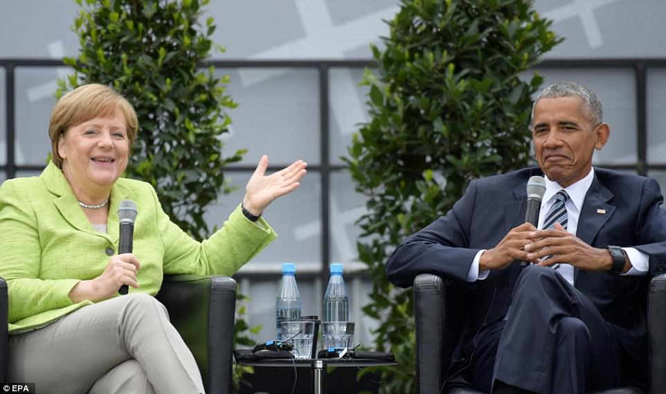 German Chancellor Angela Merkel (left) was criticized by some for inviting former President Obama (right) to Germany, as they called it a publicity stunt to attract votes for her election this fall