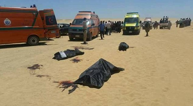 Shocking pictures have started to emerge showing bodies covered with black sheets near the scene of the atrocity