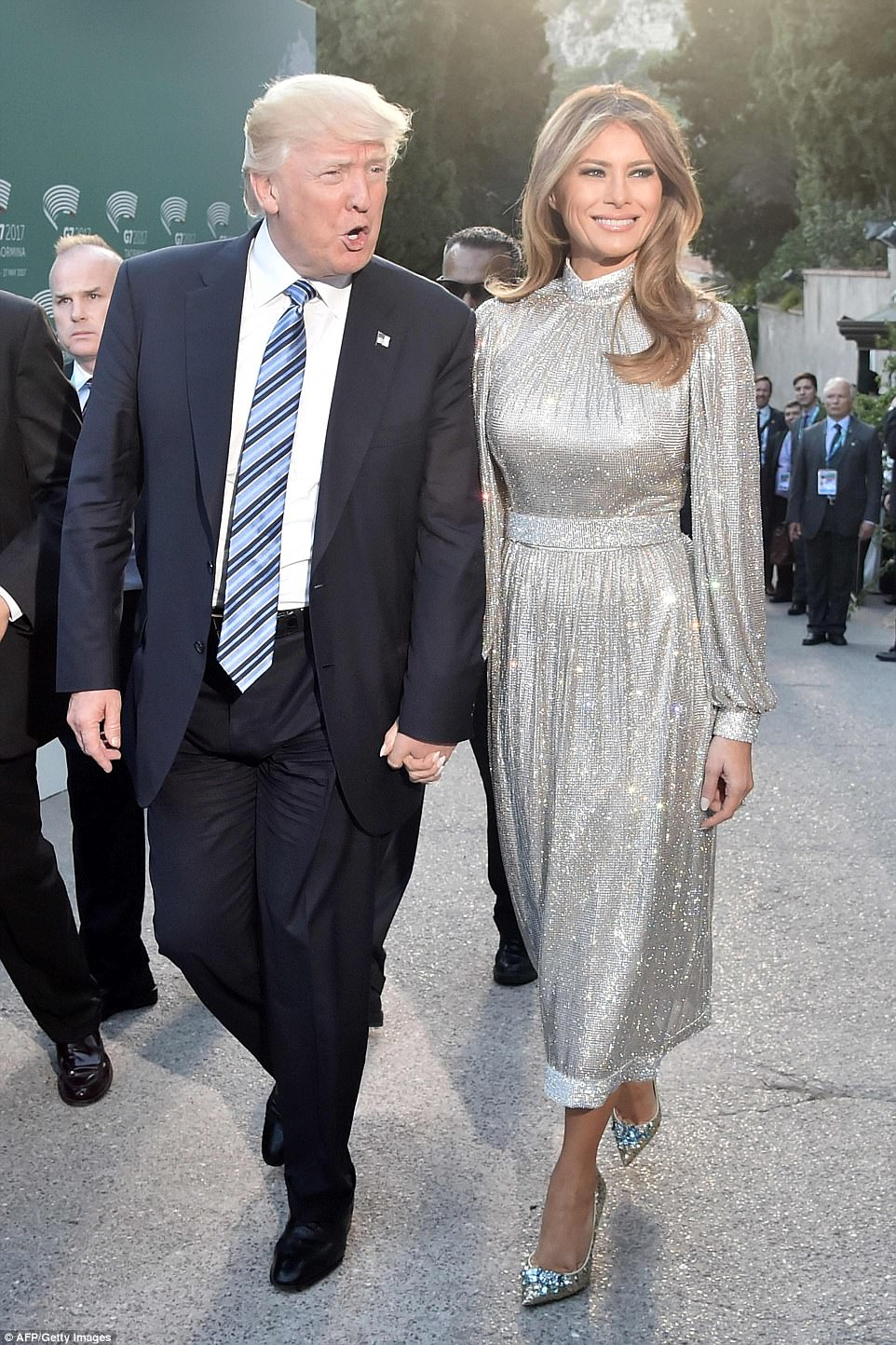 Melania and Donald Trump held hands as they arrived at the Ancient Theatre of Taormina for a concert by the La Scala Philharmonic Orchestra on Friday evening, alongside President Trump's fellow G7 leaders and their partners