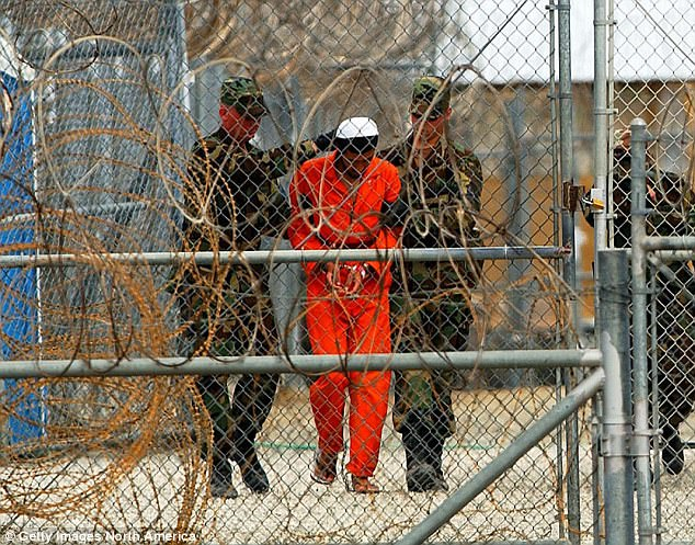Tarique Ghaffur warns there are too many extremists on the streets for police and MI5 officers to monitor (file photo of a prisoner at in Guantanamo Bay, Cuba)